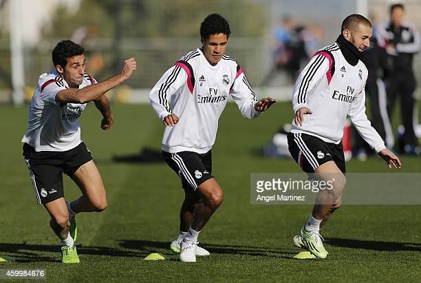 Alvaro Arbeloa Raphael Varane and Karim Benzema of Real Madrid exercise during a training session at Valdebebas training ground on December 5 2014 in...