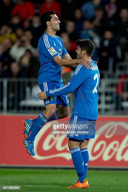 Alvaro B Morata of Real Madrid CF celebrates scoring their fifth goal with teammate Alvaro Arbeloa during the La Liga match between UD Almeria and...
