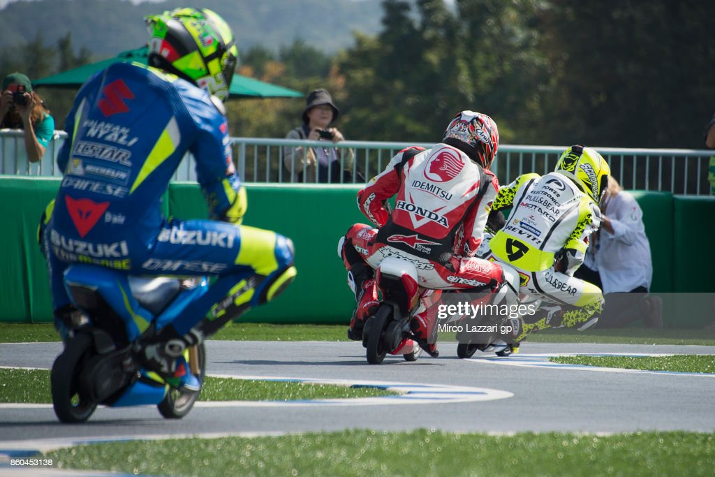 Alvaro Bautista of Spain and Pull&Bear Aspar Team leads the field and rides the mini-bike during the pre-event 'The mini-battle between the MotoGP riders and children with electric mini bikes at Mobi Park at Motegi' ahead of the MotoGP of Japan at Twin Ring Motegi on October 12, 2017 in Motegi, Japan.