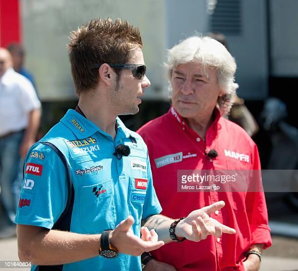 Alvaro Bautista of Spain and team Rizla Suzuki MotoGP speaks with Angel Nieto in paddock before the second free practice of the Grand Prix of Italy...