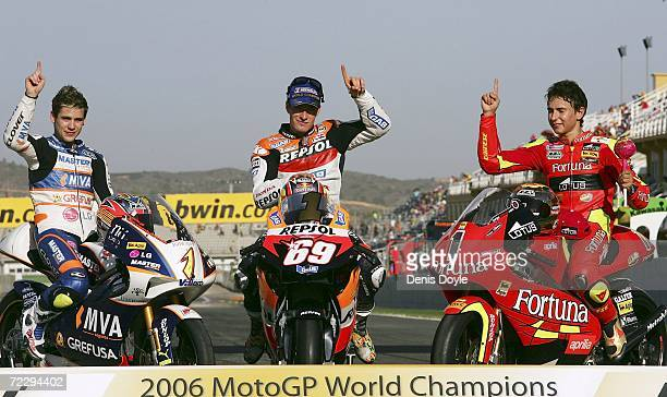Alvaro Bautista of Spain celebrates with Nicky Hayden of the US and Jorge Lorenzo of Spain after they won the World Title Championship in the 125cc...