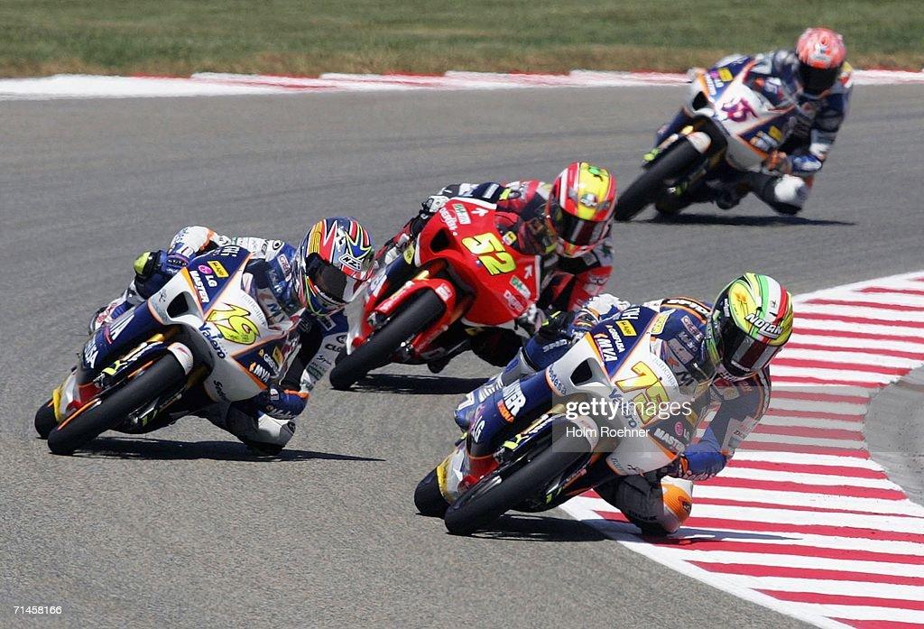 Alvaro Bautista of Spain Lukas Pesek of Czech Republic and Mattia Pasini of Italy compete in the 125cc race of the German Moto Grand Prix at the...