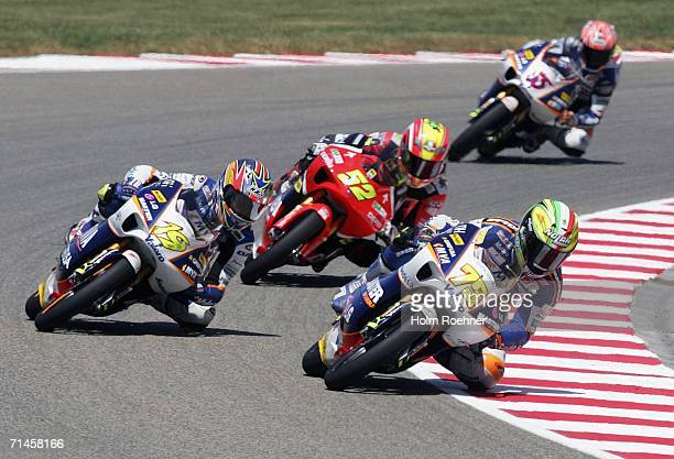Alvaro Bautista of Spain Lukas Pesek of Czech Republic and Mattia Pasini of Italy compete in the 125cc race of the German Moto Grand Prix at the...