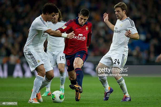 Alvaro Cejudo of CA Osasuna competes for the ball with Pepe of Real Madrid CF and his teammate Asier Illarramendi during the Copa del Rey Round of 8...