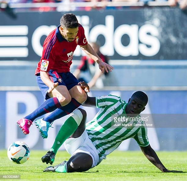 Alvaro Cejudo of CA Osasuna duels for the ball with Alfred Ndiaye of Real Betis Balompie during the La Liga match between CA Osasuna and Real Betis...