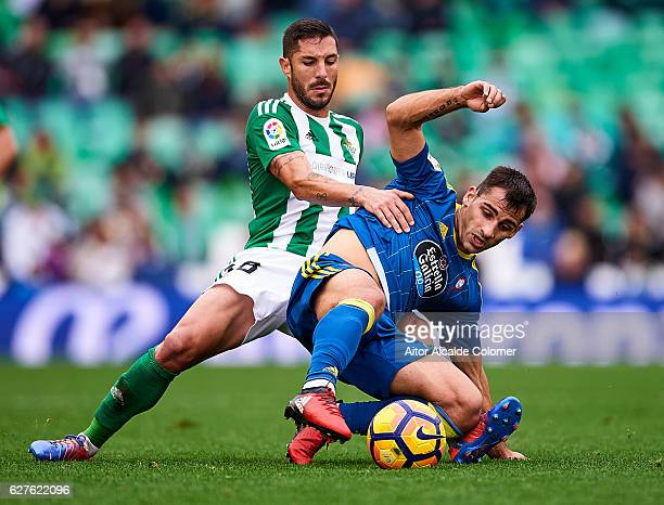 Alvaro Cejudo of Real Betis Balompie competes for the ball with Jonathan Castro of RC Celta de Vigo during La Liga match between Real Betis Balompie...