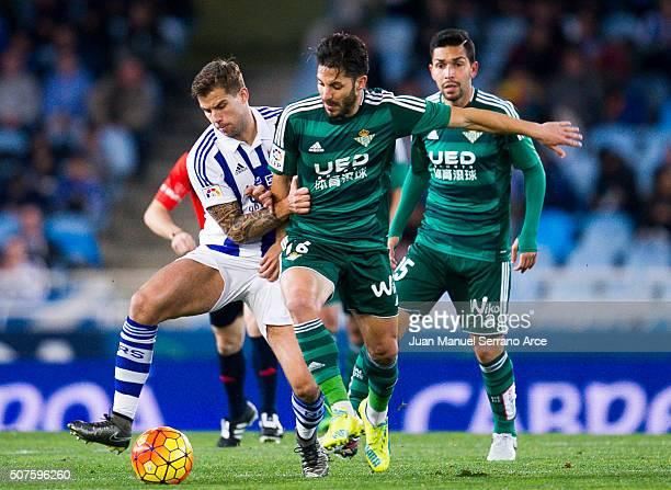 Alvaro Cejudo of Real Betis Balompie duels for the ball with Inigo Martinez of Real Sociedad during the La Liga match between Real Sociedad de Futbol...