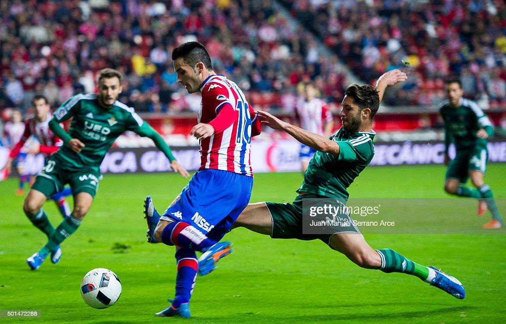 Alvaro Cejudo of Real Betis Balompie duels for the ball with Ismael Lopez of Real Sporting de Gijon during the Copa del Rey Round of 32 match between Real Sporting de Gijon and Real Betis Balompie at Estadio El Molinon on December 15, 2015 in Gijon, Spain.