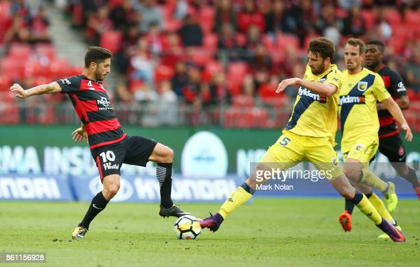 Alvaro Cejudo of the Wanderers and Antony Golec of the Mariners contest possession during the round two ALeague match between the Western Sydney...