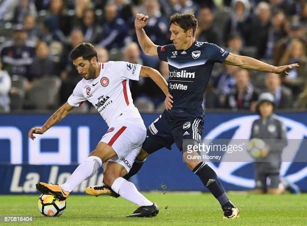 Alvaro Cejudo of the Wanderers and Mark Milligan of the Victory compete for the ball during the round five ALeague match between the Melbourne...