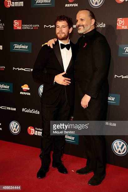 Alvaro Cervantes and Miguel Bose pose during a photocall for 'Fifth Gala Against HIV 2014' at the Museu Nacional d'Art de Catalunya on November 24...