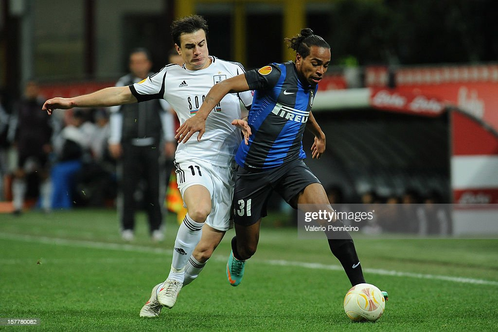 Alvaro Daniel Pereira (R) of FC Internazionale Milano competes with Nicolas Canales of Neftci PFK during the UEFA Europa League group H match between FC Internazionale Milano and Neftci PFK on December 6, 2012 in Milan, Italy.