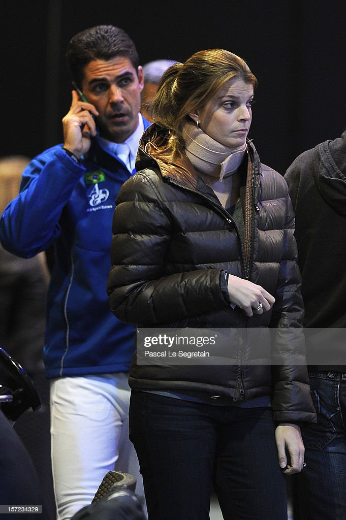Alvaro de Miranda (L) and Athina Onasis attend the Gucci Paris Masters 2012 at Paris Nord Villepinte on November 30, 2012 in Paris, France.