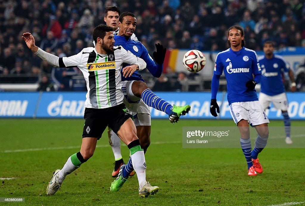 Alvaro Dominguez (15) of Borussia Moenchengladbach challenges Joel Matip (32) of Schalke 04 during the Bundesliga match between FC Schalke 04 and Borussia Moenchengladbach at Veltins Arena on February 6, 2015 in Gelsenkirchen, Germany.