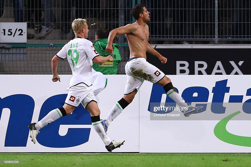 Alvaro Dominguez of Moenchengladbach (R) celebrates the second goal with <a gi-track='captionPersonalityLinkClicked' href=/galleries/search?phrase=Mike+Hanke&family=editorial&specificpeople=206515 ng-click='$event.stopPropagation()'>Mike Hanke</a> of Moenchengladbach (L) during the Bundesliga match between Borussia Moenchengladbach and Hamburger SV at Borussia Park Stadium on September 26, 2012 in Moenchengladbach, Germany.