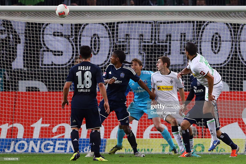 Alvaro Dominguez of Moenchengladbach (R) scores the second goal during the Bundesliga match between Borussia Moenchengladbach and Hamburger SV at Borussia Park Stadium on September 26, 2012 in Moenchengladbach, Germany.