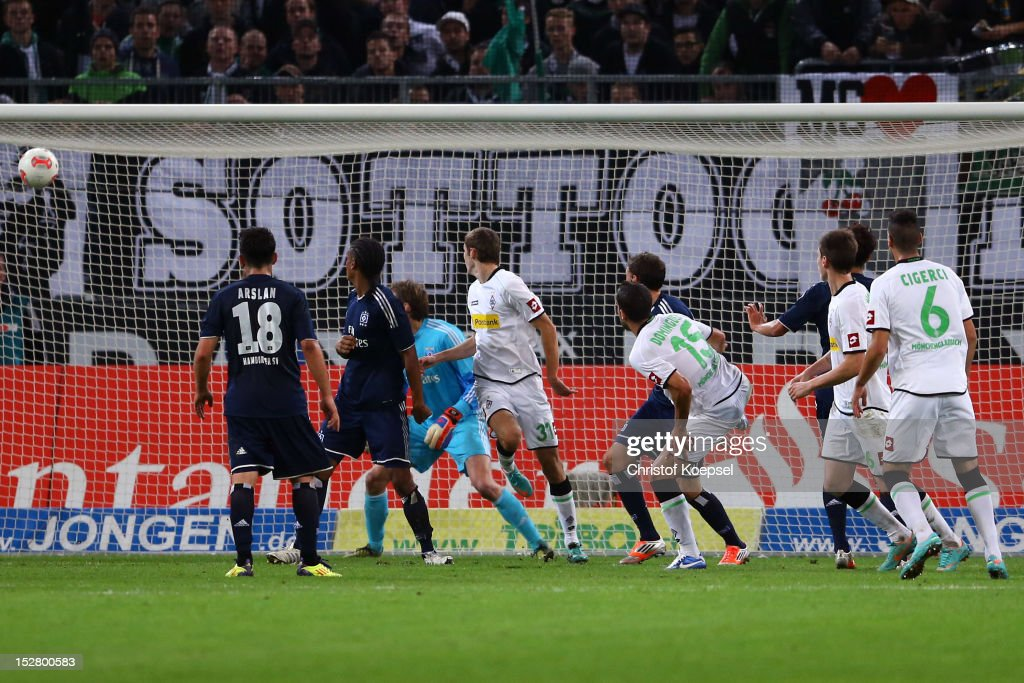 Alvaro Dominguez of Moenchengladbach (3rd R) scores the second goal during the Bundesliga match between Borussia Moenchengladbach and Hamburger SV at Borussia Park Stadium on September 26, 2012 in Moenchengladbach, Germany.