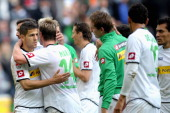 Alvaro Dominguez Soto of Moenchengladbach and teammate Thorben Marx celebrate after the Bundesliga match between VfL Borussia Moenchengladbach and...