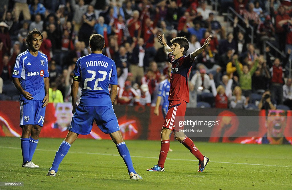 <a gi-track='captionPersonalityLinkClicked' href=/galleries/search?phrase=Alvaro+Fernandez&family=editorial&specificpeople=2946918 ng-click='$event.stopPropagation()'>Alvaro Fernandez</a> of the Chicago Fire #4 scores a goal in front of <a gi-track='captionPersonalityLinkClicked' href=/galleries/search?phrase=Alessandro+Nesta&family=editorial&specificpeople=213983 ng-click='$event.stopPropagation()'>Alessandro Nesta</a> #14 of Montreal Impact and <a gi-track='captionPersonalityLinkClicked' href=/galleries/search?phrase=Davy+Arnaud&family=editorial&specificpeople=2291388 ng-click='$event.stopPropagation()'>Davy Arnaud</a> #22 in an MLS match on September 15, 2012 at Toyota Park in Bridgeview, Illinois. The Chicago Fire defeated the Montreal Impact 3-1.