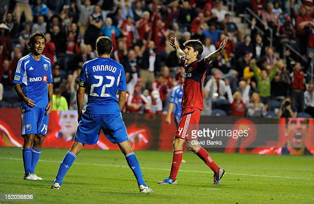 Alvaro Fernandez of the Chicago Fire scores a goal in front of Alessandro Nesta of Montreal Impact and Davy Arnaud in an MLS match on September 15...
