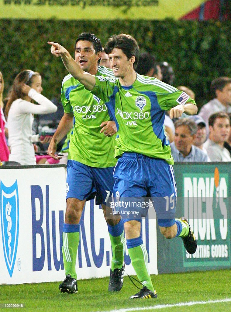 <a gi-track='captionPersonalityLinkClicked' href=/galleries/search?phrase=Alvaro+Fernandez&family=editorial&specificpeople=2946918 ng-click='$event.stopPropagation()'>Alvaro Fernandez</a> #15 of the Seattle Sounders celebrates after scoring during a match against the Kansas City Wizards at Community America Ballpark in Kansas City, Kansas on October 9, 2010. The Sounders won 2-1.