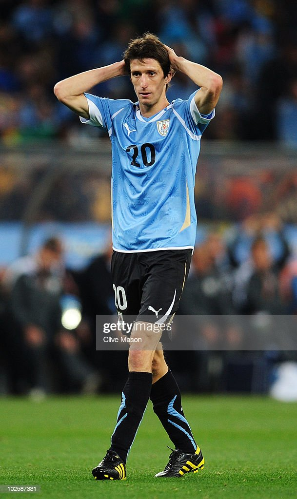 <a gi-track='captionPersonalityLinkClicked' href=/galleries/search?phrase=Alvaro+Fernandez&family=editorial&specificpeople=2946918 ng-click='$event.stopPropagation()'>Alvaro Fernandez</a> of Uruguay reacts during the 2010 FIFA World Cup South Africa Quarter Final match between Uruguay and Ghana at the Soccer City stadium on July 2, 2010 in Johannesburg, South Africa.