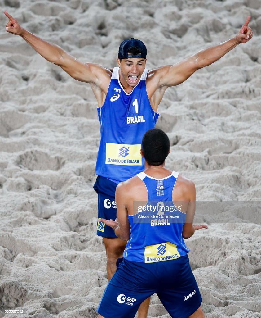 Alvaro Filho #02 and Saymon Barbosa #01 of Brazil celebrate a point during the main draw match against Brazil at Parque Olimpico during day two of the FIVB Beach Volleyball World Tour Rio, on May 19, 2017 in Rio de Janeiro, Brazil.