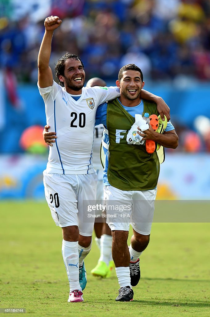 Alvaro Gonzalez (L) and Walter Gargano of Uruguay celebrate the 1-0 win after the 2014 FIFA World Cup Brazil Group D match between Italy and Uruguay at Estadio das Dunas on June 24, 2014 in Natal, Brazil.