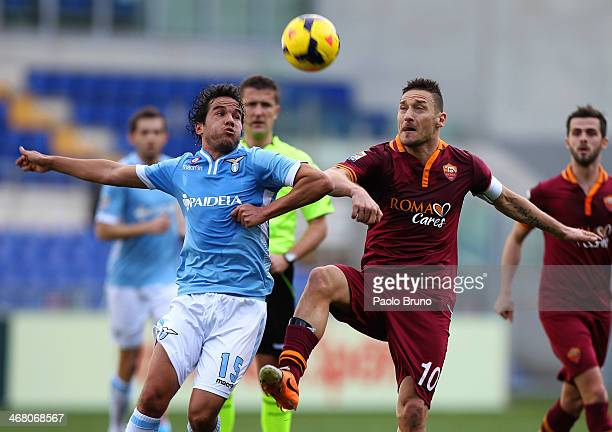 Alvaro Gonzalez of SS Lazio competes for the ball with Francesco Totti of AS Roma during the Serie A match between SS Lazio and AS Roma at Stadio...