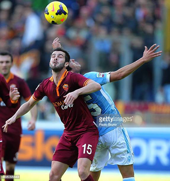 Alvaro Gonzalez of SS Lazio competes for the ball with Miralem Pjanic of AS Roma during the Serie A match between SS Lazio and AS Roma at Stadio...