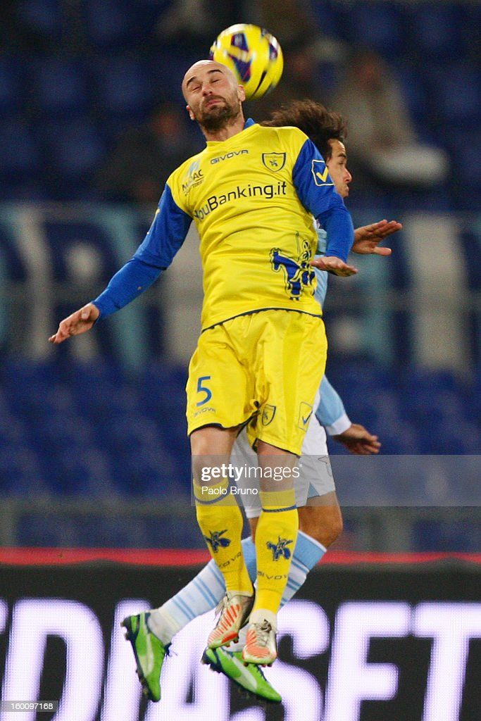 Alvaro Gonzalez (R) of S.S. Lazio competes for the ball with Roberto Guana of AC Chievo during the Serie A match between S.S. Lazio and AC Chievo Verona at Stadio Olimpico on January 26, 2013 in Rome, Italy.