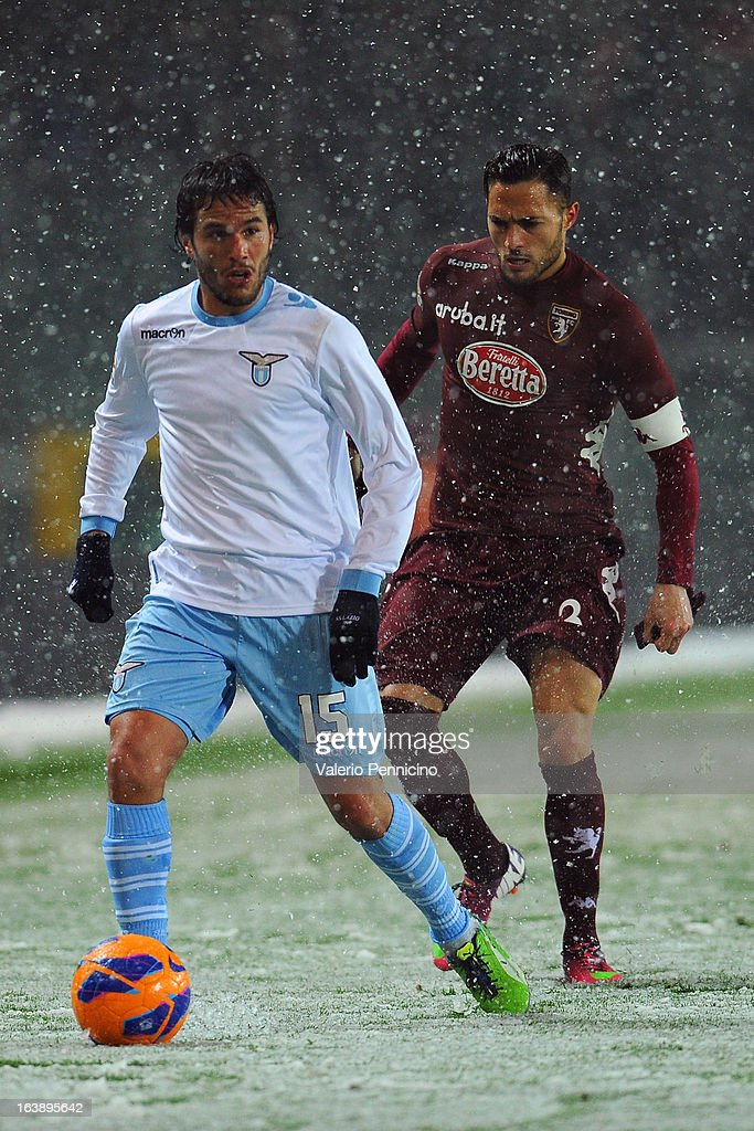 Alvaro Gonzalez (L) of S.S. Lazio in action against Danilo D'Ambrosio (L) of Torino FC during the Serie A match between Torino FC and S.S. Lazio at Stadio Olimpico di Torino on March 17, 2013 in Turin, Italy.