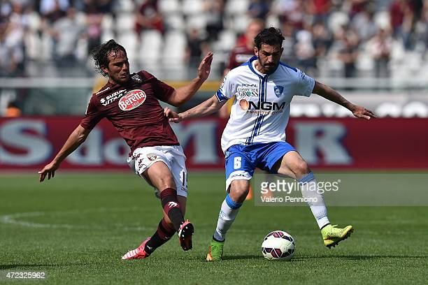 Alvaro Gonzalez of Torino FC competes with Riccardo Saponara of Empoli FC during the Serie A match between Torino FC and Empoli FC at Stadio Olimpico...