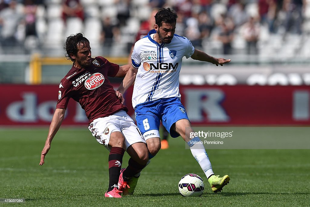 <a gi-track='captionPersonalityLinkClicked' href=/galleries/search?phrase=Alvaro+Gonzalez+-+Soccer+Player&family=editorial&specificpeople=2261829 ng-click='$event.stopPropagation()'>Alvaro Gonzalez</a> (L) of Torino FC tackles <a gi-track='captionPersonalityLinkClicked' href=/galleries/search?phrase=Riccardo+Saponara&family=editorial&specificpeople=7597684 ng-click='$event.stopPropagation()'>Riccardo Saponara</a> of Empoli FC during the Serie A match between Torino FC and Empoli FC at Stadio Olimpico di Torino on May 6, 2015 in Turin, Italy.