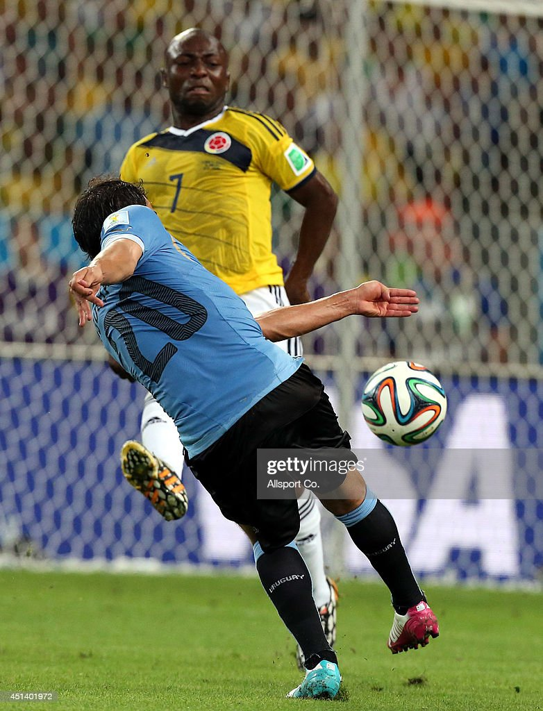 <a gi-track='captionPersonalityLinkClicked' href=/galleries/search?phrase=Alvaro+Gonzalez+-+Soccer+Player&family=editorial&specificpeople=2261829 ng-click='$event.stopPropagation()'>Alvaro Gonzalez</a> of Uruguay shoots while <a gi-track='captionPersonalityLinkClicked' href=/galleries/search?phrase=Pablo+Armero&family=editorial&specificpeople=631297 ng-click='$event.stopPropagation()'>Pablo Armero</a> intercepts during the 2014 FIFA World Cup Brazil Round of 16 match between Colombia and Uruguay at Maracana on June 28, 2014 in Rio de Janeiro, Brazil.