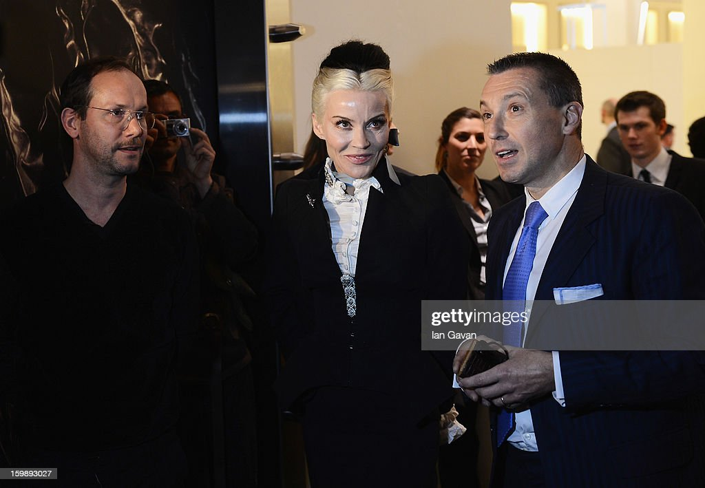 Alvaro Maggini (L), Creative Director of Roger Dubuis and Jean-Marc Pontroue (R), CEO of Roger Dubuis talk to <a gi-track='captionPersonalityLinkClicked' href=/galleries/search?phrase=Daphne+Guinness&family=editorial&specificpeople=213037 ng-click='$event.stopPropagation()'>Daphne Guinness</a>, friend of the brand as she visits their booth during the 23rd Salon International de la Haute Horlogerie at the Geneva Palexpo on January 22, 2013 in Geneva, Switzerland.
