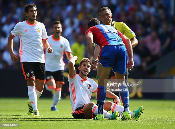Alvaro Medran of Valencia argues with Mile Jedinak of Palace after a challenge from Jedinak led to Medran throwing the ball at him during the Pre...