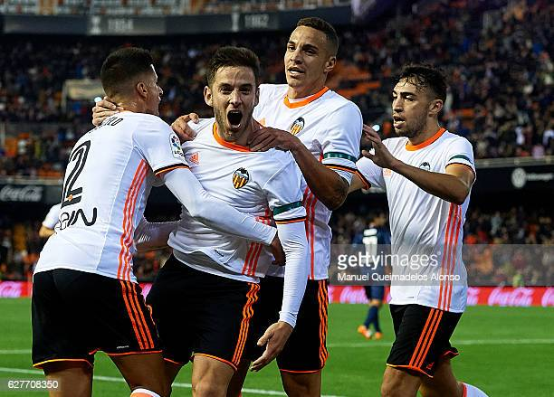 Alvaro Medran of Valencia celebrates scoring his team's second goal with his teammates Joao Cancelo Rodrigo Moreno and Munir El Haddadi during the La...