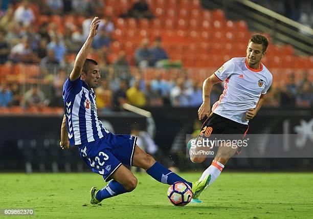 Alvaro Medran of Valencia CF and Nenad Krsticic of Deportivo Alaves during the La Liga match between Valencia CF vs Deportivo Alaves at Mestalla...