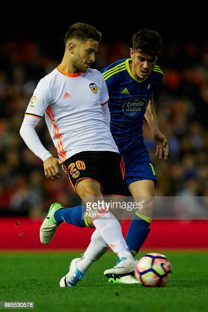 Alvaro Medran of Valencia CF competes for the ball with Jozabed of Real Club Celta de Vigo during the La Liga match between Valencia CF and Real Club...