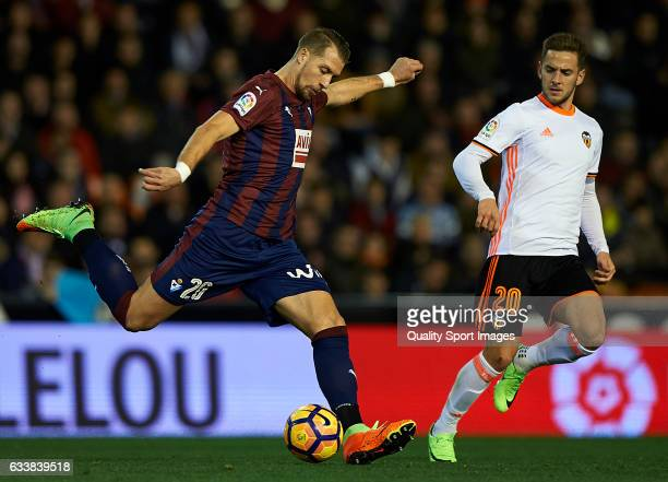 Alvaro Medran of Valencia competes for the ball with Florian Lejeune of Eibar during the La Liga match between Valencia CF and SD Eibar at Mestalla...