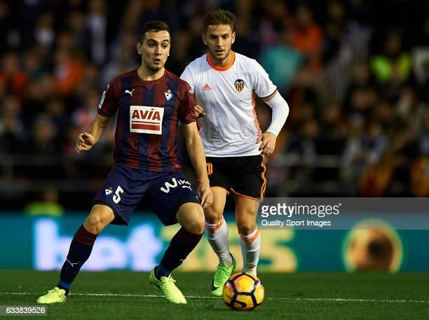 Alvaro Medran of Valencia competes for the ball with Gonzalo Escalante of Eibar during the La Liga match between Valencia CF and SD Eibar at Mestalla...