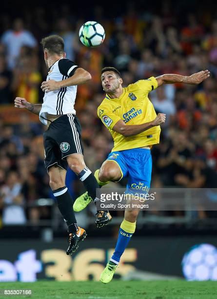Alvaro Medran of Valencia competes for the ball with Jonathan Calleri of Las Palmas during the La Liga match between Valencia and Las Palmas at...