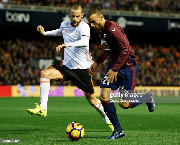 Alvaro Medran of Valencia competes for the ball with Pedro Leon of Eibar during the La Liga match between Valencia CF and SD Eibar at Mestalla...