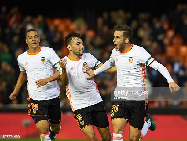 Alvaro Medran Rodrigo Moreno and Munir El Haddadi of Valencia CF celebrates their goal during the La Liga match between Valencia CF vs Malaga CF at...