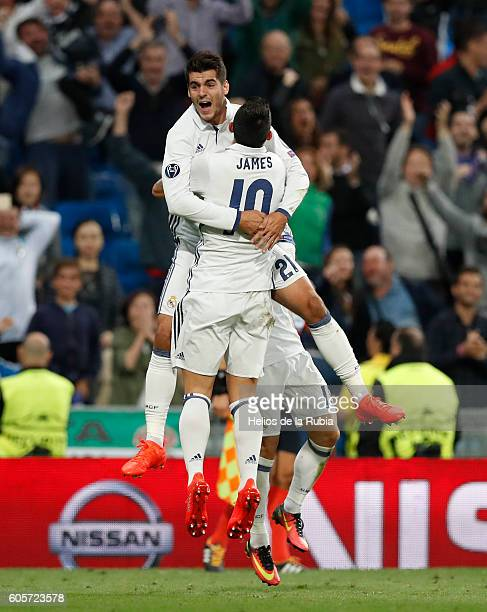 Alvaro Morata and James Rodriguez of Real Madrid celebrate after scoring during the UEFA Champions League Group F match between Real Madrid CF and...