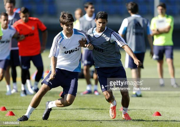 Alvaro Morata and Juanfran Moreno of Real Madrid exercise during a training session at Valdebebas training ground on July 17 2012 in Madrid Spain
