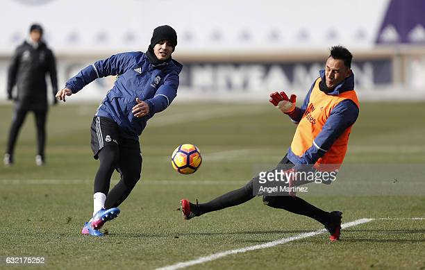 Alvaro Morata and Keylor Navas of Real Madrid in action during a training session at Valdebebas training ground on January 20 2017 in Madrid Spain