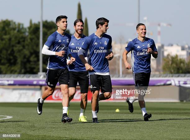 Alvaro Morata Lucas Vazquez Marco Asensio and Sergio Ramos of Real Madrid during a training session at Valdebebas training ground on March 17 2017 in...