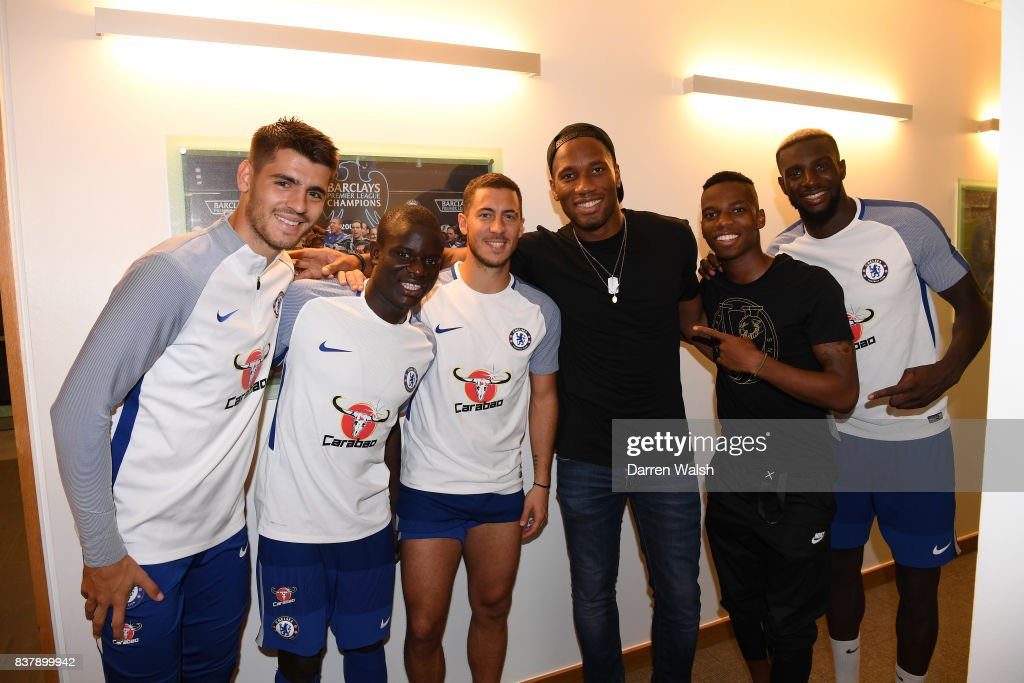 Alvaro Morata, N'Golo Kante, Eden Hazard, Charly Musonda and Tiemoue Bakayoko of Chelsea with Ex Chelsea player Didier Drogba after a training session at Chelsea Training Ground on August 23, 2017 in Cobham, England.